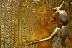 Golden Goddess Serket. GENEVA, SWITZERLAND - DECEMBER 17: Ancient egyptian gold statue of the protecting goddess Serket at the Tutankhamun exhibition:  December Royalty Free Stock Photography