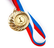 Golden or gold medal isolated closeup. Golden medal isolated on white Stock Photos