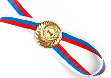 Golden or gold medal isolated closeup. Golden medal isolated on white Royalty Free Stock Photos