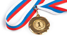 Golden or gold medal isolated closeup. Golden medal isolated on white Royalty Free Stock Image