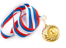 Golden or gold medal isolated closeup. Golden medal isolated on white Stock Images