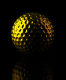 Golden Golf ball Stock Image
