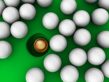 Golden Golf ball in cup with serounded golf ball Royalty Free Stock Photography