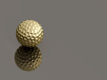 Golden golf ball on reflective background Stock Photo