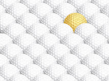 Golden golf ball, standing out from the rest Stock Photo