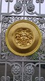 Golden Gorgon on the iron cast Stock Photo