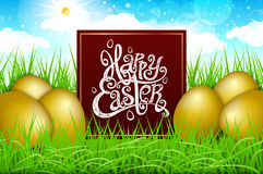 Golden gpld eggs in a field of grass with blue sky. happy easter lettering modern calligraphy, vector Stock Photo