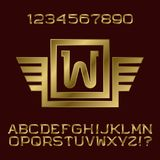 Golden gradient letters and numbers with initial monogram in winged frame. Stylish font kit for logo design Stock Image