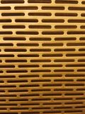 Golden gradient Metal surface texture with repetitive pattern royalty free stock photography