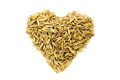 Golden grains wheat in the form of a heart. Isolated on white background Stock Photography