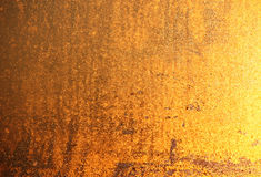 Golden grainy background Stock Photography