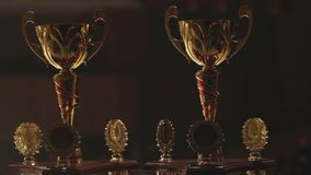 Golden grand prix cups for successful sports contest winners, competitive spirit