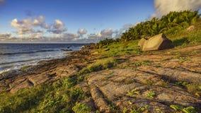Golden granite rocks on the seychelles 2 Stock Image