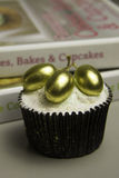 Golden Grapes Cupcake. With cooking book royalty free stock photos