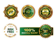 Golden green badges guarantee Royalty Free Stock Images