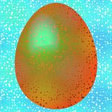 Golden green bird egg on turquoise blue Royalty Free Stock Photo