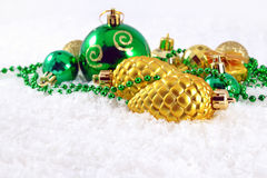 Golden and green Christmas decorations Stock Images