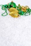 Golden and green Christmas decorations Royalty Free Stock Image