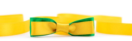 Golden and green ribbon border. Golden ribbon and green border isolated on white background stock images