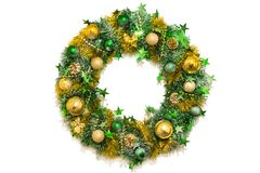 Golden green shiny Christmas decoration wreath of tinsel, bows, balls, beads, cones and stars. Golden green shiny Christmas wreath of tinsel, bows, balls, beads Royalty Free Stock Photo