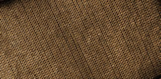 Illuminated golden grid texture. A golden grid illuminated by the sun giving off a faint glow Royalty Free Stock Photography