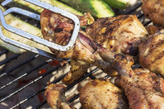 Golden Grilled Wings On Charcoal Grill Being Flipped With Tongs Royalty Free Stock Photo
