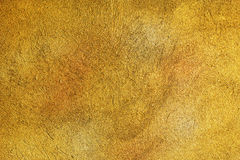 Golden grunge cement wall Royalty Free Stock Photography