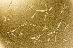 Golden grungy background with five pointed stars Stock Images