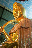 Golden guan yin the goddess of mercy Royalty Free Stock Photography