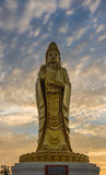 Golden Guanyin statue Buddha with Twilight sky background. royalty free stock photo