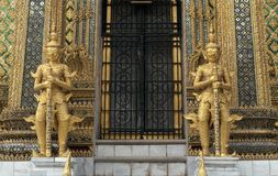 The golden guardians of The Emerald Buddha Temple Royalty Free Stock Image