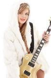 Golden guitar girl in fur Stock Image