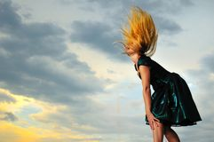 Golden hair. Girl in a dress outside in nature, with golden hair Royalty Free Stock Image