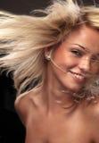 Golden Hair Beauty. Beautiful Blond Woman Fluttering Her Gorgeous Hair Stock Images