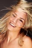 Golden Hair Flutter. Gorgeous Blond Woman Fluttering Her Golden Hair Royalty Free Stock Photo
