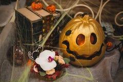 Golden halloween pumpkin autumn decor Royalty Free Stock Photos