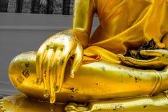 Golden hand Buddha. Golden Buddha lay light Royalty Free Stock Photos