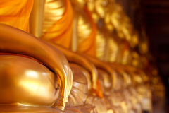 Golden hand buddha. Thai art Buddha statue stock photography