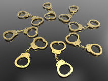 Golden hand cuffs circular pattern Royalty Free Stock Photos