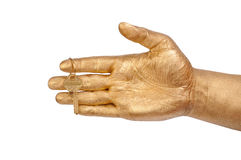 Golden hand with a gold key Royalty Free Stock Photo