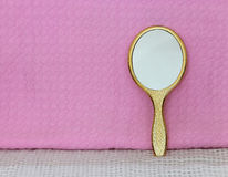 Golden hand mirror Royalty Free Stock Image