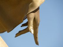 Golden hand pointing down Royalty Free Stock Image