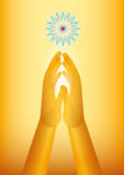 Golden hand praying. Golden hands praying with a flower as symbol of spirituality Stock Images