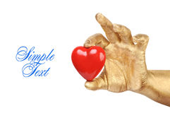 Golden hand with a red heart Stock Image