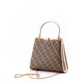 Golden handbag. Golden Grecian pattern ladies handbag with chain Stock Photo
