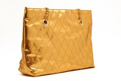 Golden handbag. Large bag in glamorous gold Royalty Free Stock Photography