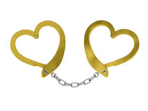 Golden handcuffs of love isolated on white Royalty Free Stock Photography