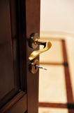 Golden door handle from a luxury hotel room Stock Photos