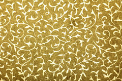 Golden handmade art paper with floral pattern royalty free stock image