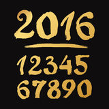 Golden Handmade drawn Numbers 0-9 written with a brush Stock Photo